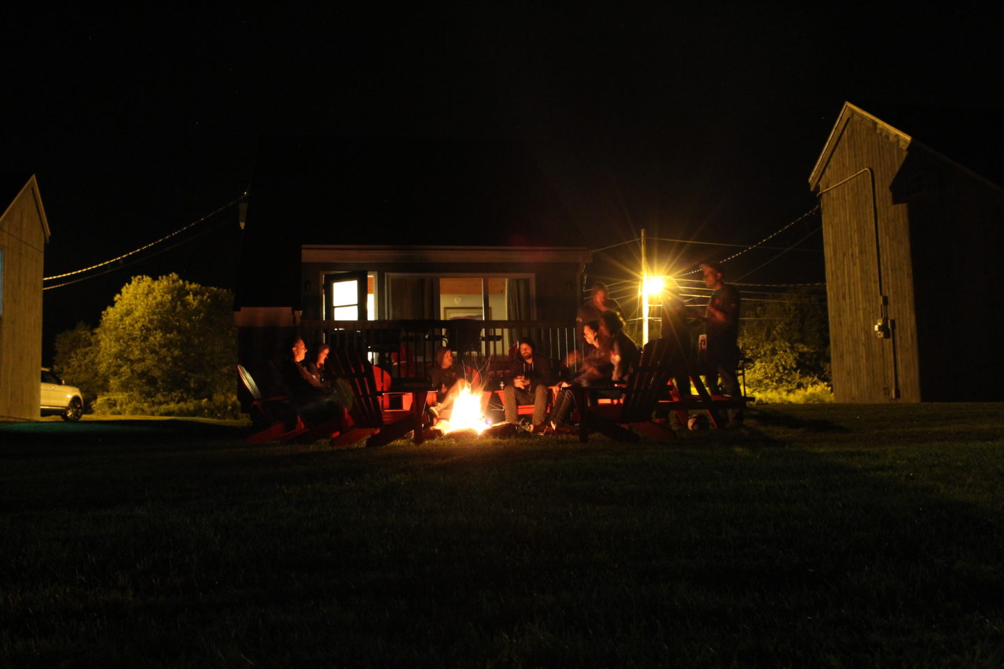 The team gathered around a bonfire